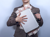 Woman in suit holds metal briefcase full of money Royalty Free Stock Photo