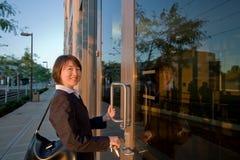Woman in Suit Opens Door - Horizontal Stock Images