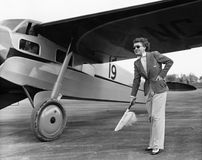 Woman in suit with plane Royalty Free Stock Images