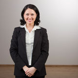 Woman in suit posing Stock Image