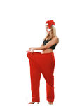Woman in a suit santa Stock Image