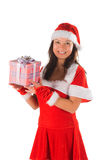 The woman in a suit santa, gives gifts Royalty Free Stock Photos