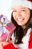 The woman in a suit santa, gives gifts Royalty Free Stock Photo