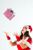 The woman in a suit santa, gives gifts Royalty Free Stock Images