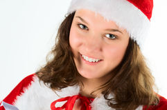 The woman in a suit santa, smiling. Royalty Free Stock Images