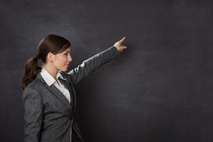 Woman in a suit showing blackboard Stock Photos