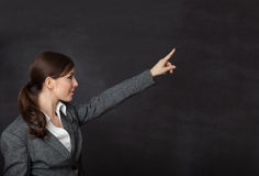 Woman in a suit showing blackboard Stock Photography