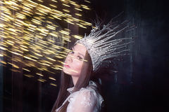 Woman in a suit of the Snow Queen Stock Photo