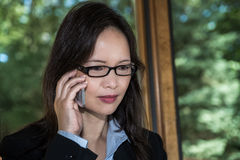Woman in suit speaking on phone Royalty Free Stock Photography