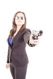 Woman in suit and sunglasses holding a gun Stock Photos