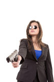 Woman in suit and sunglasses holding a gun Royalty Free Stock Image
