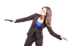 Woman in suit and sunglasses holding a gun Stock Photography