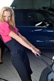 Woman with suitcase. Travelling woman take suitcase from a car Royalty Free Stock Image
