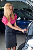 Woman with suitcase. Travelling woman take suitcase from a car Royalty Free Stock Photos