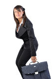 Woman and suitcase. Woman is takin a bag on white background Royalty Free Stock Photos