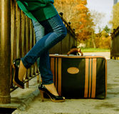 Woman with a suitcase Stock Photo