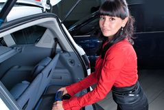 Woman with suitcase. Travelling woman take suitcase from a car Stock Images
