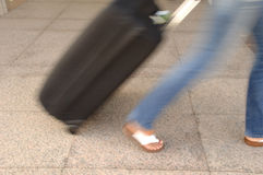 Woman and suitcase Stock Photos