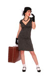 Woman with a suitcase Stock Images