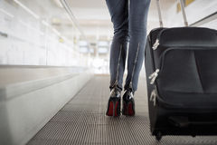 Woman with suitcase in airport Stock Image