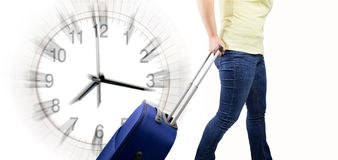 Woman with suitcase arrival at time Stock Images