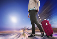 Woman with suitcase awaiting aircraft royalty free stock image