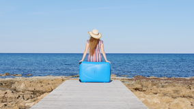 Woman with suitcase on the beach stock footage