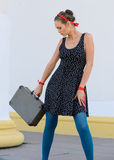 Woman with suitcase Stock Photography