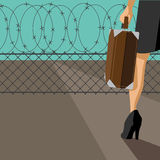 Woman with suitcase confronted by barbed wire fence Stock Photos