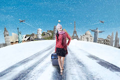 Woman with suitcase and famous monument Stock Photography