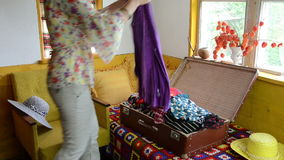 Woman suitcase full cloth stock video
