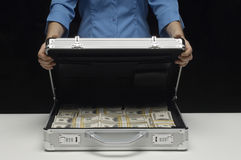 Woman With Suitcase Full Of Dollars Stock Images