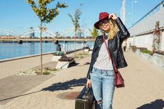 Woman with suitcase getting ready for her trip Royalty Free Stock Image