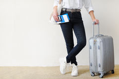Woman with the suitcase goes on a journey. Travel insurance. I checked the font license, I`m 100% sure Royalty Free Stock Photography