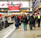 Woman with suitcase heading for her train at Munich Central Station in Gremany. Woman heads for her train at Munich Central Station in Gremany Stock Photography