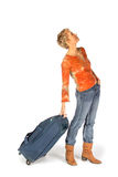 Woman with suitcase looking a timetable Royalty Free Stock Image