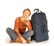 Woman with suitcase looking up Stock Photo