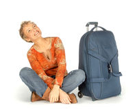 Woman with suitcase looking up Royalty Free Stock Photography