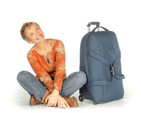 Woman with suitcase looking up Stock Photos