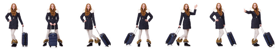 The woman with suitcase preparing for winter vacation Stock Photography