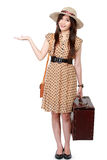 Woman with suitcase presenting Royalty Free Stock Photos