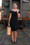 Woman with suitcase on railroad Royalty Free Stock Photo
