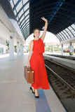 Woman with a suitcase at the railway station Stock Photo