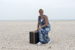 Woman with suitcase Stock Photos