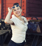 Woman with a suitcase standing near the retro train Stock Photography