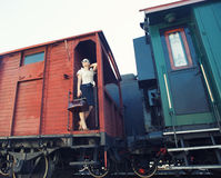 Woman with a suitcase standing on the train Royalty Free Stock Images