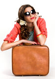 Woman with suitcase thinking of traveling Stock Photography