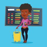 Woman with suitcase and ticket at the airport. Royalty Free Stock Photo