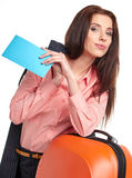 Woman with a suitcase and a ticket on a white background Stock Photo