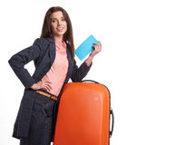 Woman with a suitcase and a ticket on a white background Stock Photography